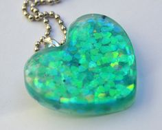Hearts https://www.etsy.com/listing/98052106/heart-pendant-filled-with-irridescent