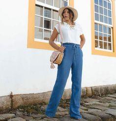 faa26397f Calça Pantalona com cintura ajustável com cordão. Composição  100% Liocel P veste  38