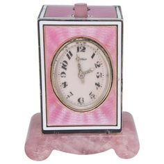 Cartier Sterling Silver and Pink Enamel Minute Repeater Desk Clock circa 1920s,  Geneve Clock Co., retailed by Cartier, sterling silver and pink guilloche enamel minute repeating desk clock, circa 1902s. Rose quartz base and thumb push button, diamond-set platinum hands and diamond-set platinum monogram to the top.