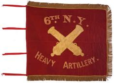 "6th Regiment Artillery (Heavy), NY Volunteers Flank Marker.  The New York State Battle Flag Collection includes two flank markers carried by the 6th Regiment Artillery, NY Volunteers. This flag is made from two pieces of red wool hand-sewn together along the horizontal middle. The markers include yellow, silk inscriptions and crossed cannons pieced into the red wool field. Polyester tie-backs, each approximately 10"" long and not original to the flags, are included along the hoist edge."