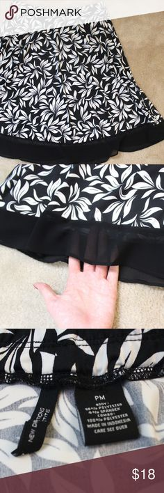 """New Directions Black & White Flowy Skirt This skirt looks brand new. Barely been worn. Stretchy waist and flowy. Petite size. Sheer black at bottom edge. Waist: 28"""" Length: 22"""" new directions Skirts"""