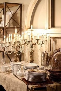Farmhouse buffet.  Linen tablecloth, candlelight, and plenty of pretty dishes for guests