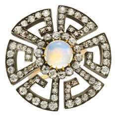 Antique Moonstone Diamond gold Ring | From a unique collection of vintage more rings at https://www.1stdibs.com/jewelry/rings/more-rings/