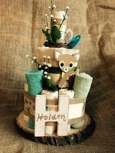Best 12 A smaller version of the woodland themed diaper cake. Built with over 25 useable, chlorine-free diapers (Seventh Generation SZ Including 4 baby wash cloths, 1 binky & served on a rustic wooden slab. May be customized with babys name as s Baby Shower Winter, Baby Shower Fun, Baby Shower Themes, Shower Ideas, Diaper Cake Boy, Mini Diaper Cakes, Shower Bebe, Baby Shower Decorations For Boys, Baby Shower Gifts For Boys