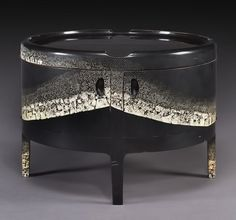 Black lacquer drum table, eggshell highlights – Jean Dunand