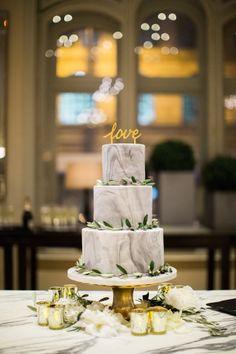 Mori Lee for a Stylish Wedding in Manchester. Stunning grey and white marble effect wedding cake. Image by Melissa Beattie Photography. Read more: http://bridesupnorth.com/2016/07/19/marble-metallic-mori-lee-for-a-stylish-wedding-in-manchester-chorcha-glen/ #wedding #love #cake