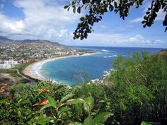 This is Frigate Bay in Saint Kitts as viewed from Timothy Hill on the South East Peninsular. Saint Kitts (also known more formally as Saint Christopher Island (Saint-Christophe in French) is an island in the West Indies. The west side of the island borders the Caribbean Sea, and the eastern coast faces the Atlantic Ocean.
