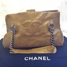 Chanel Bag Tan Leather with Chains 100% authentic. Purchased pre owned, do not have the papers. It does come with the original dust bag. 6/7 years old, patina is beautiful. I am selling because the clasp doesn't stay clipped (as seen in collage) and the inner structure bar is slipping out of place aka missing one small nail as seen in collage) the bag is still very functional! I just don't use it often enough to get it fixed CHANEL Bags Totes