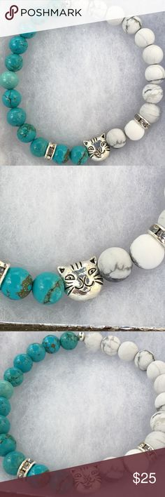 """Blue White Turquoise Howlite Kitty Cat Bracelet This lovely bracelet is made with natural blue magnesite and matte white howlite. It features a silver tone kitty cat charm. This piece is on elastic and will stretch to fit up to an 8"""" wrist.   All PeaceFrog jewelry items are handmade by me! Take a look through my boutique for more unique creations. PeaceFrog Jewelry Bracelets"""