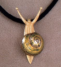 Snail pendant brooch by John Paul Miller