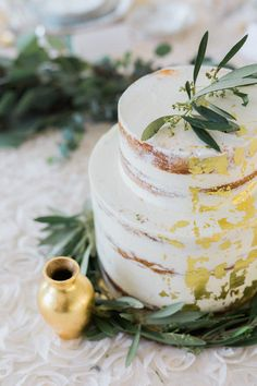 partially naked cake with gold foil