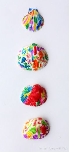 Make beautiful rainbow Melted Crayon Seashells out of shells from the Dollar Tree. #kids #children #craft #diy #shell #seashell #art #idea #creative #inexpensive #preschool #prek #kindergarten #crayons #color #weekend #home #easy #simple #shells #beach