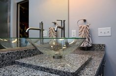 Vessel sink in master bathroom in a condo with an industrial style and a contemporary feel.
