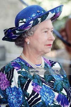 The Queen On A Visit To Cyprus Wearing A Blue Multi-coloured Dress Designed By Fashion Designer John Anderson And Hat By Milliner Philip Somerville With A Three Strand Pearl Necklace