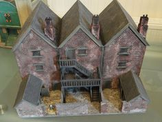 These model buildings are made by a very talented blogger, who doesn't say much. He has tables of wonderfully made scale terrain.