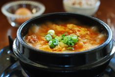 A quick and easy soondubu jjigae recipe made with kimchi. It& a stew made with uncurdled (extra soft) tofu and kimchi. Sundubu Jjigae Recipe, Soondubu Jjigae, Kimchi, Korean Dishes, Korean Food, Korean Bbq, Vietnamese Food, Korean Street, Gourmet