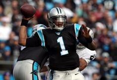CHARLOTTE, NC - DECEMBER 23: Cam Newton #1 of the Carolina Panthers drops back to pass against the Oakland Raiders during their game at Bank of America Stadium on December 23, 2012 in Charlotte, North Carolina. (Photo by Streeter Lecka/Getty Images)