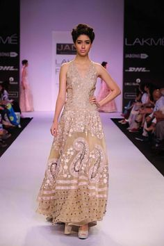JADE by Monica and Karisma at Lakme Fashion Week Summer Resort 2014 gold paisley dress. More here: http://www.indianweddingsite.com/jade-monica-karishma-lakme-fashion-week-summer-resort-2014/