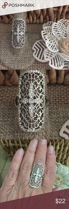 """Sz 8.5 Knuckle to knuckle Cross Ring This ring goes Knuckle to Knuckle for s big look. 1/2 ct of simulated diamonds and a cool cross design. Silver tone over brass base metal (so don't wear this one in the pool) it measures almost 1 1/2"""". Sz 8.5. New with tags. R415. Loc G3 The Metal Daisy Jewelry Rings"""