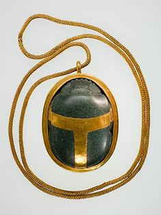 Serpentine/gold Heart Scarab of Hatnefer: mother of Senenmut, one of Hatshepsut's best known officials. Her tomb was found undisturbed: Thebes, Sheikh Abd el-Qurna, Tomb of Hatnefer & Ramose (below TT71)