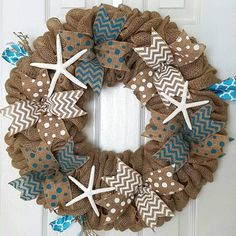 """Beautiful 18"""" Burlap wreath covered in lots of ribbon with colors being primarily Teal/White. Accented with 3 starfish. This wreath would look perfect on any front door, or over a fireplace."""