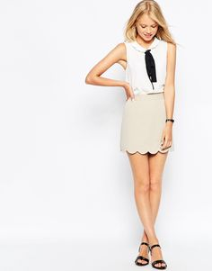A line Mini Skirt with Scallop Hem in BLACK. $34