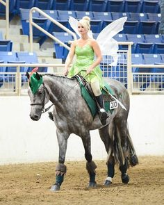 Tinker Bell riding a horse dressed as Peter Pan!