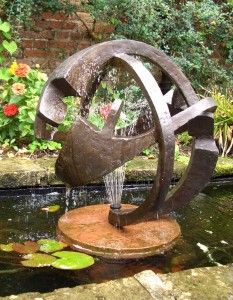 As MN #LandscapeDesign specialists,we often use sculpture and water features to accent our landscape plans.  This free-form cast bronze 'Continuity' Garden Sculpture has both, since it is also a fountain.  For landscape design in the Minneapolis area, visit http://www.aldmn.com