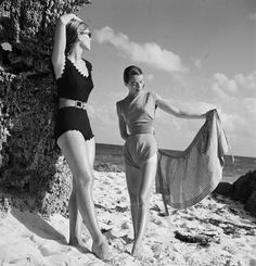Canada 1946 | Sabine (right) models a 'Pantung Loincloth' swimsuit designed by Claire McCardell and Janet Stevenson (left) models 'Hug Me Tight' swimsuit designed by Joset Walker  Image by Genevieve Naylor/CORBIS