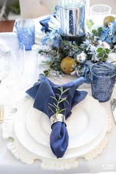 Learn how to create these elegant fall table settings with a blue and white color palette using white dishes, blue and white chinoiserie bowls, navy napkins, sparkly mercury glass and a transitional holiday centerpiece accented Summer Table Decorations, Holiday Centerpieces, Table Centerpieces, Tree Decorations, White Table Settings, Christmas Table Settings, Place Settings, Blue Christmas Decor, Christmas Decorations