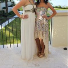 Sherri hill prom dress High low neutral and bedazzled prom dress. Tan color and different color dazzle to it from beads to sequels. Only worn once. Feel free to make offers willing to negotiate Sherri Hill Dresses Prom