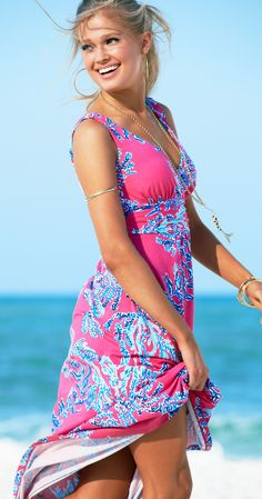 Lilly Pulitzer Sloane V-Neck Maxi Dress shown in Capri Pink Samba. The v-neck and jersey fabric are perfect for traveling, going out for lunch or spending the day at home.