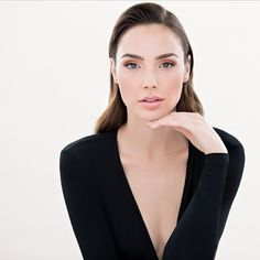 Gal Gadot posing with deep v black dress.  www.jserene.com
