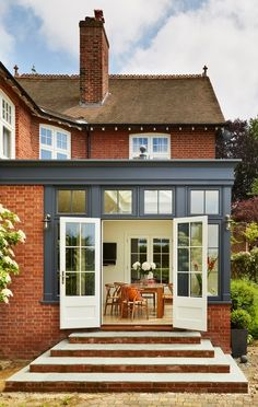 This South Facing Orangery Was Painted In A Modern Westbury Black Orangerie Extension, Orangery Extension Kitchen, Brick Extension, House Extension Design, Rear Extension, Garden Room Extensions, House Extensions, Brick Porch, Westbury Gardens