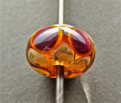 Handmade lampwork glass focal bead by fireforgedstudio