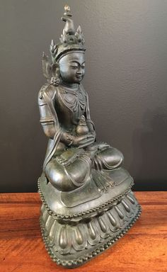 Seated Buddha, Kingdom of Arakan, Mrauk U Period, circa 16th/17th century. The Buddha is portrayed seated in padmasana upon a high double lotus throne, hands in dhyana mudra, a ritual vessel rests in his upturned palms. Find important Asian art for sale on CuratorsEye.com.