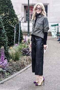 Olivia arrived at the Giambattista Valli show in Tibi leather culottes and black turtleneck, with a Topshop military jacket, Westward Leaning sunglasses and heels.
