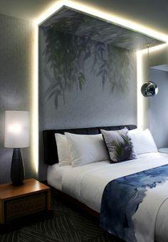 deco chambre adulte avec luminaire boule métallique suspendue au dessus du lit couleurs grisatres et bleuatres