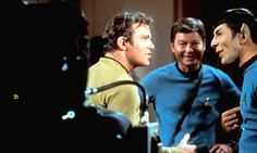 1966 A rare smile from Spock as Nimoy corpses during filming of Star Trek with William Shatner and DeForest Kelley.