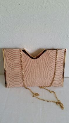 New (never used) - Peach alligator print clutch with shoulder strap and 1 zipper pocket on the inside. Brand new.