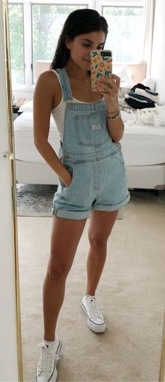 Magical Outfit Ideas To Beat The Summer Heat, Summer Outfits, blue denim dungaree shorts Mode Outfits, Short Outfits, Trendy Outfits, Fashion Outfits, Shorts Outfits For Teens, Fashion Trends, Denim Dungaree Shorts, Dungarees Outfits, Denim Shorts Outfit Summer