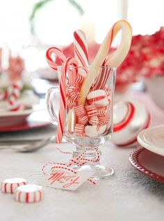 Top your Christmas table with a quick, easy and festive holiday centerpiece. Filled with peppermint candies, inexpensive glasses make quick centerpieces, decorations or party favors. Tie a coordinating ribbon around the stems for an added festive touch.