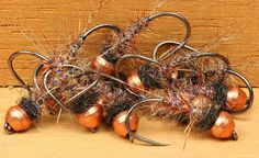 Tails: Coq de Leon Fibers, Medium Pardo. Ribbing: FLY DK Synthetic Quill Body, UV Pearl. Body: Tungsten Wire Dubbing Brush (Red Fox Squirrel Guard Hairs,
