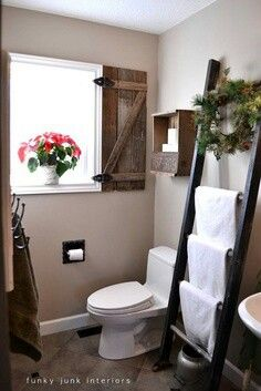 Ladder towel rack idea for my bathroom, also I love the wooden look in this photo!!   <3