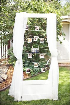 bridal shower decorations: improvise a photobooth with a Polaroid camera and a clothesline.
