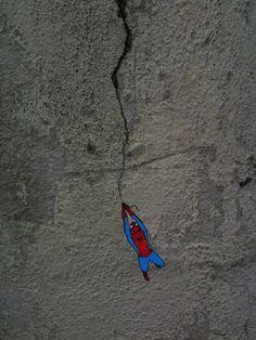 Spiderman holding onto cracks - 106 of the most beloved Street Art Photos – Year 2012