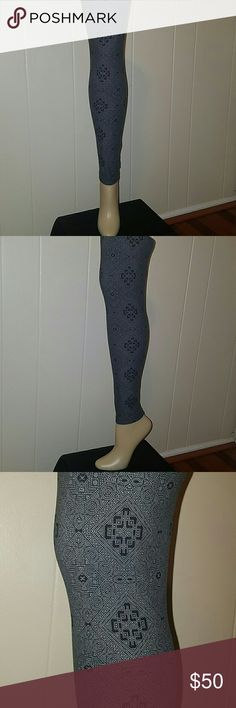 Lularoe HTF Leggings NWOT*  Os/onesize. Very Rare and Hard to find Pair of Butter leggings by lularoe in onesize/OS.. Gorgeous Patterned leggings with Grey, Black & white Colors throughout. Lularoe . Made in Indonesia * Very true to size . New without tags. LuLaRoe Pants Leggings