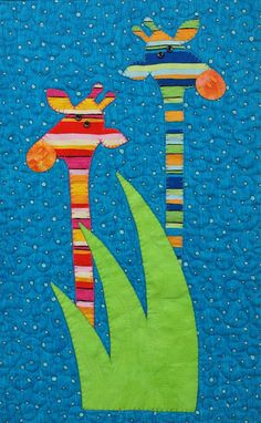 Hot Possum cot quilt, quilted by Sympaguita Quilts;  Love the Australian bright colors and lively designs!