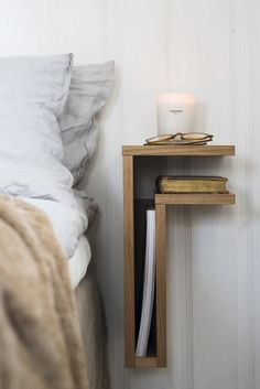 A bedside table that is formed as the letter F. Very decorative way to place your book.