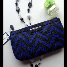 Nine West Chevron Wristlet Gorgeous NEW wristlet.  Trendy chevron with cool detailing that looks like beads of water.  Unable to photograph inside without removing tags.  Perfect for a night out without being a boring black clutch. Nine West Bags Clutches & Wristlets